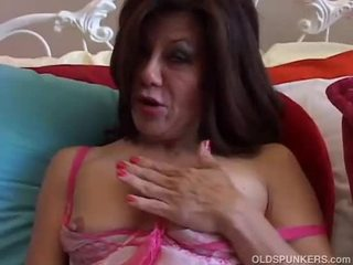 Sexy mature lady plays with her wet pussy